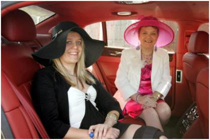 Kay and her mum Posing inside a bentley car