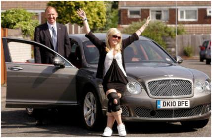 Kay Posing outside a bentley car