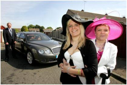 Kay and her mum Posing outside a bentley car